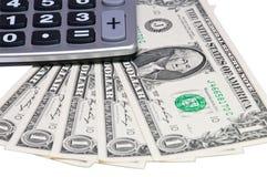 Dollari e calcolatore Fotografia Stock Libera da Diritti