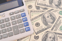 Dollari e calcolatore Immagini Stock Libere da Diritti