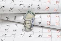Dollari e calendario Fotografia Stock Libera da Diritti