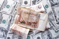 Dollari e dinaro Immagini Stock Libere da Diritti
