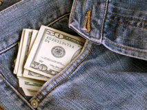 Dollari e jeans II Fotografia Stock