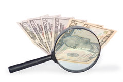 Dollari e lente d'ingrandimento Fotografie Stock