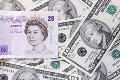 Dollari e libbre Fotografia Stock
