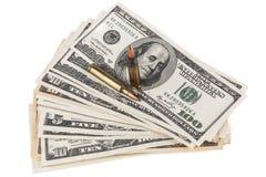 Dollari e pallottole del fucile Fotografia Stock Libera da Diritti