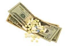 Dollari e pillole Fotografie Stock Libere da Diritti