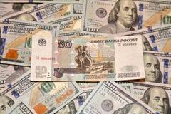 Dollari e rubli Fotografie Stock