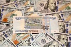 Dollari e rubli Immagine Stock