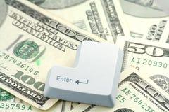 Dollari e un tasto di immissione Immagine Stock