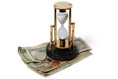 Dollari e una clessidra Fotografie Stock Libere da Diritti