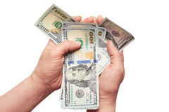 Dollari in mani su un fondo bianco Fotografia Stock Libera da Diritti