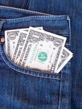 Dollari nella tasca posteriore dei jeans Fotografia Stock