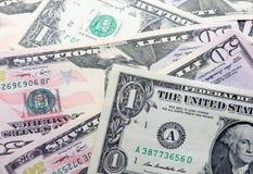 Dollari su fondo bianco Immagini Stock