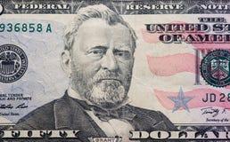 Dollari su fondo bianco Fotografie Stock