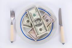 Dollari sulla zolla dell'alimento fotografia stock