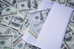 Dollari in una busta Immagine Stock