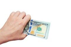 Dollari in una mano su un fondo bianco Fotografia Stock Libera da Diritti