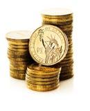 Dollarmuntstuk en gouden geld Stock Afbeeldingen