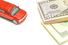 Dollarnota's en rode auto Royalty-vrije Stock Afbeeldingen