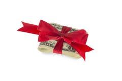 Dollarnota's met rood lint Royalty-vrije Stock Afbeeldingen