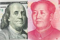 Dollaro americano contro gli yuan della Cina Fotografia Stock