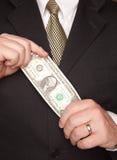 Dollaro Bill della holding dell'uomo d'affari Fotografie Stock Libere da Diritti