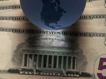 Dollaro del globo Immagini Stock