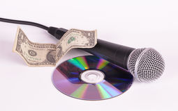 Dollaro del microfono e disco del disco compatto Fotografia Stock Libera da Diritti