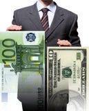 Dollaro dell'uomo EUR di affari Immagini Stock Libere da Diritti