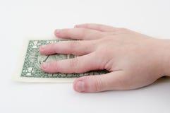 Dollaro della holding della mano del `s del bambino. Immagine Stock Libera da Diritti