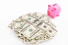 Dollaro della pila e della banca Piggy o Fotografia Stock Libera da Diritti