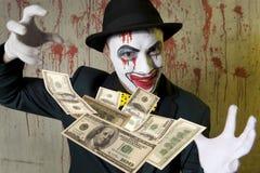 Dollaro di lancio del pagliaccio diabolico Fotografia Stock Libera da Diritti
