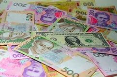 Dollaro di U.S.A. e dell'ucranino Hryvnia Immagine Stock