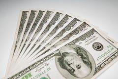 Dollaro di valuta dei soldi - $ 100 come fondo Immagini Stock
