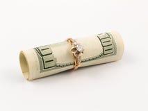 Dollaro ed anello dorato Immagini Stock Libere da Diritti