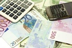 Dollaro, euro banconote, calcolatore e cellulare Immagini Stock Libere da Diritti