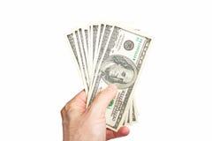 Dollaro maschio del holdingthousand della mano Immagini Stock