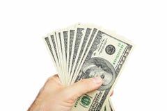 Dollaro maschio del holdingthousand della mano Immagine Stock