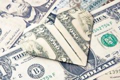 Dollarorigamiherz im Banknotenhintergrund Moneygami Lizenzfreie Stockfotos
