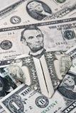 Dollarorigamiherz im Banknotenhintergrund Moneygami Lizenzfreies Stockfoto
