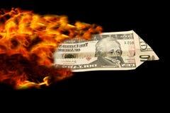 Dollarplain auf Feuer Stockbilder