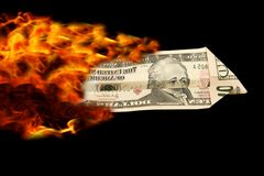 Dollarplain on fire. Fire behind a dollar looking like plain Stock Images