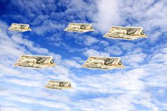 Dollarplains. Dollars flying over the sky Stock Image