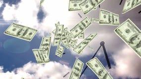 Dollarräkningar som faller med over himmelbakgrund
