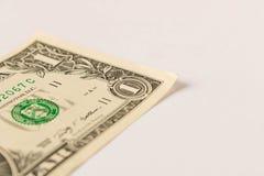 1 dollarrekening op een witte achtergrond Sluit omhoog Het concept besparingsgeld royalty-vrije stock afbeelding