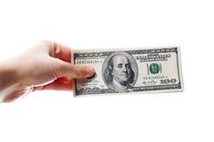 Dollars à disposition sur le blanc Image stock