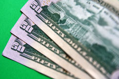Dollars. Three 50 dollars banknote on the green background Stock Images