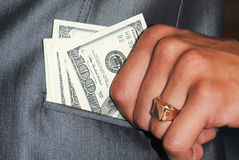 Dollars. Hundred US dollars in a hand. Photo Stock Images