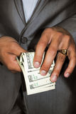 Dollars. Hundred US dollars in a hand. Photo Stock Photography