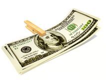 Dollars. In clothespin on white background isolated Royalty Free Stock Photo