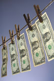 Dollars. Five one dollar bills hanging on a clothesline Stock Image